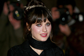 Actress Zooey Deschanel poses for photographers as she arrives for the U.K. premiere of 'Yes Man' in Leicester Square
