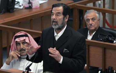 Ousted Iraqi leader Saddam Hussein addresses the court during his trial in Baghdad