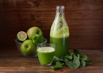 Green fresh pressed juice, detox, Apple, lime and spinach, in a glass container