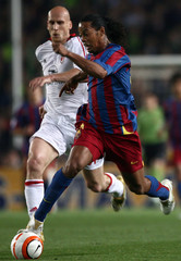 AC Milan's Stam fights for the ball with Barcelona's Ronaldinho during their Champions League semi-final soccer match in Barcelona