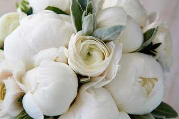 Wedding bouquet of white peonies and ranunculuses.Wedding floristry