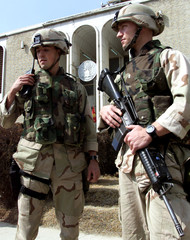 TWO U.S. MARINES STAY ON GUARD AT KABUL U.S. EMBASSY.