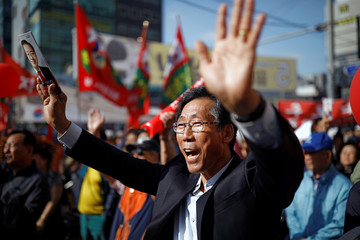 A supporter of Hong Joon-pyo, the presidential candidate of the Liberty Korea Party, cheers during Hong's election campaign rally in Seoul