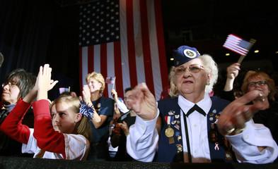 Supporters applaud U.S. Democratic presidential nominee Barack Obama in Canton