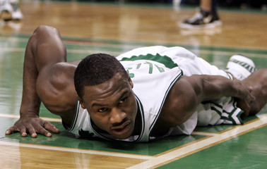 Boston Celtics Tony Allen holds onto his leg while lying on the floor in the third quarter of their NBA basketball game against Indiana Pacers in Boston