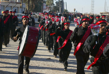 Supporters of Shi'ite cleric Moqtada al-Sadr march during a parade in commemoration of the death anniversary of Sadeq al-Sadr in Najaf