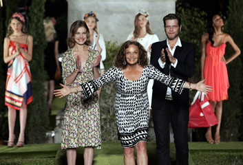 U.S. fashion designer Von Furstenberg acknowledges applause after showing a preview of her 2009 resort wear collection in Florence