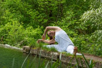Girl in white doing yoga