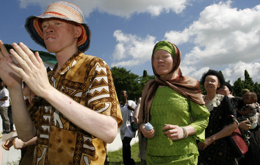 Participants march towards Mnazi Mmoja grounds during Tanzania Albino Day celebrations in Dar es Salaam