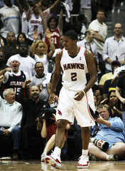 Atlanta Hawks Johnson celebrates after a three-pointer against the Miami Heat during Game 7 in the first round of the NBA Eastern Conference basketball playoffs in Atlanta