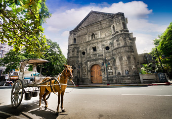 Horse Drawn Carriage parking in front of Malate church , Manila Philippines.