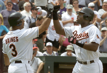 BALTIMORE ORIOLES' HAROLD BAINES AND CHARLES JOHNSON.