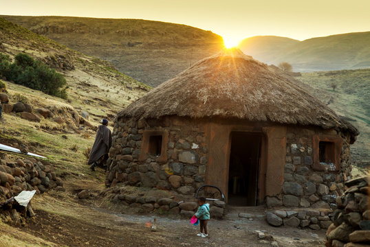 Sunset behind Lesotho hut