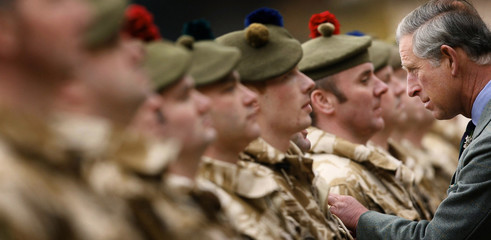 Britain's Prince Charles presents the Iraq medal in Scotland