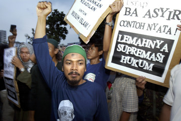 SUPPORTERS OF MUSLIM CLERIC ABU BAKAR BASHIR CHEER IN JAKARTA.