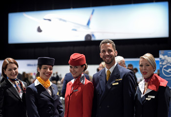 Flight attendants pose for a photo at the annual shareholders meeting of German airline Lufthansa in Hamburg