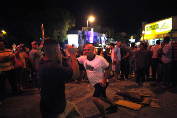 "Supporters of the ""Peace Without Borders"" concert in Cuba fight with an anti-Castro Cuban exile in Miami's little Havana"