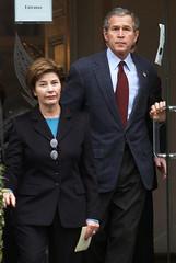 U.S. PRESIDENT GEORGE W. BUSH AND FIRST LADY LAURA BUSH LEAVE CHURCH.