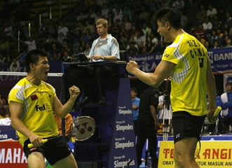 China's Guo and Xie react after beating South Korea's Lee and Hwang in the doubles final of their Thomas Cup tournament in Jakarta