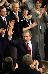 BUSH WAVES TO SUPPORTERS AT MICHIGAN CAMPAIGN RALLY.