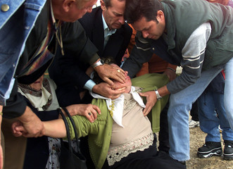 BOSNIAN MUSLIM WOMAN COLLAPSES AFTER TRYING TO IDENTIFY RELATIVES IN SANSKI MOST.
