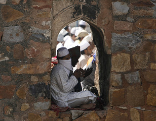Muslims offer prayers at the ruins of the Feroz Shah Kotla mosque during Eid al-Fitr in New Delhi