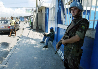 UN Peacekeepers from Brazil stand guard near the port offices in Port au Prince.