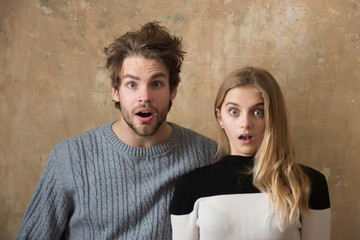couple of friends or surprised man, woman with open mouth