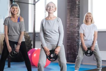 Joyful sporty women having a fitness class