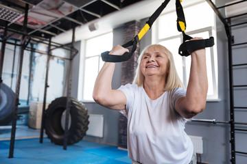 Joyful happy woman using sports equipment