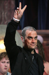 Britain's Robbie Williams wins Best Song of the past 25 years at the Brit Awards.