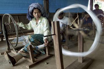 -PHOTO TAKEN 21AUG03- Former Khmer Rouge soldier Thet Nem , 33, weaves silk at Joon Noon weaving cen..