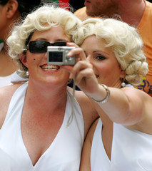 Rugby fans dressed as Monroe take pictures of themselves at the Hong Kong Sevens rugby tournament