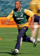 Australian team captain George Gregan runs during a training session at Subiaco Oval in Perth.
