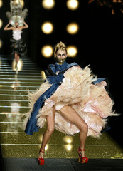 A model presents this creation during the High Fashion collection by British designer John Galliano ..