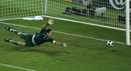 Italy's goalkeeper Buffon dives for ball after goal attempt from Spain during Euro 2008 quarter-final in Vienna
