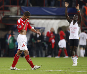 Standard Liege's Gonzalez leaves the pitch after a Champions League soccer match against Arsenal in Liege