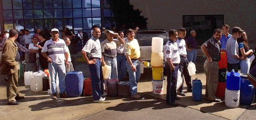 VENEZUELANS LINE UP AT A GAS STATION IN CARACAS.