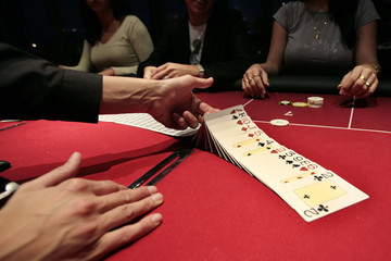 A croupier deals a hand of cards for a poker at the new Casino Barriere in Toulouse