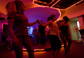 Women dancers perform at a night club in Baghdad