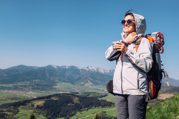Woman backpacker traveler on the top of mountain