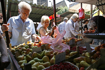 Pensioners buy fruits and vegetables at Belgrade's central green market