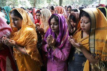 Supporters of the student wing of the Bangladesh Awami League pray in Dhaka