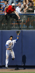New York Mets Gomez catches drive by Oakland A's Kendall in New York