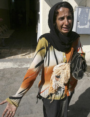 Iraqi woman cries after identifying her husband's body at Baghdad's al-Yarmouk hospital