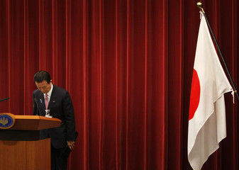 Japanese PM Aso  bows at the end of year-end news conference at his official residence in Tokyo