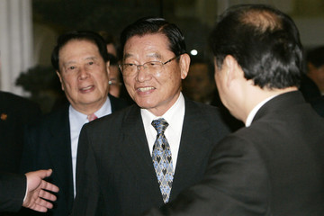 Chiang Pin-kun, chairman-designate of Taiwan's Straits Exchange Foundation, walks to a dinner party for Taiwanese businessmen in Shanghai