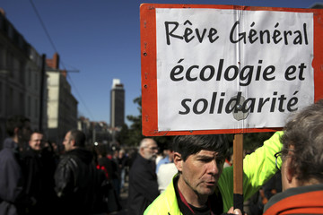 A demonstrator holds a placard during a protest march with public and private workers in Nantes