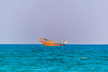 View of a dhow ship on an open sea in Oman.