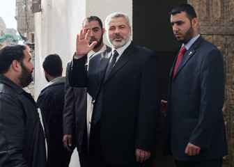 Palestinian Prime Minister Haniyeh waves as he leaves Gaza
